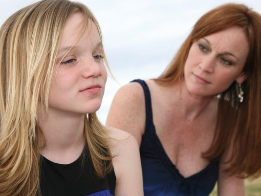 Image of mother looking at teenage daughter