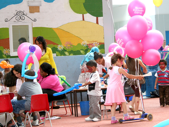 Picture of young children and all kinds of different shaped balloons at Masbro Summer party