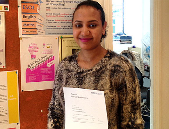 Picture of female student Thoyba with a certificate
