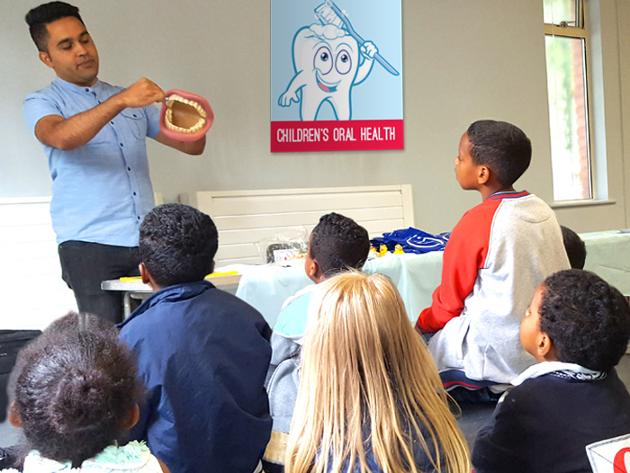 Picture of children attending an oral health class laid on by Addison Community Champions