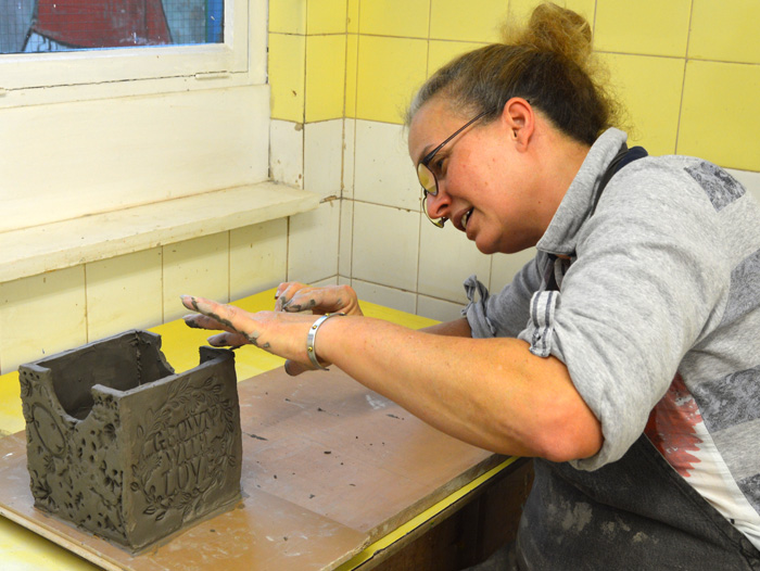 Picture of female student at Masbro pottery class