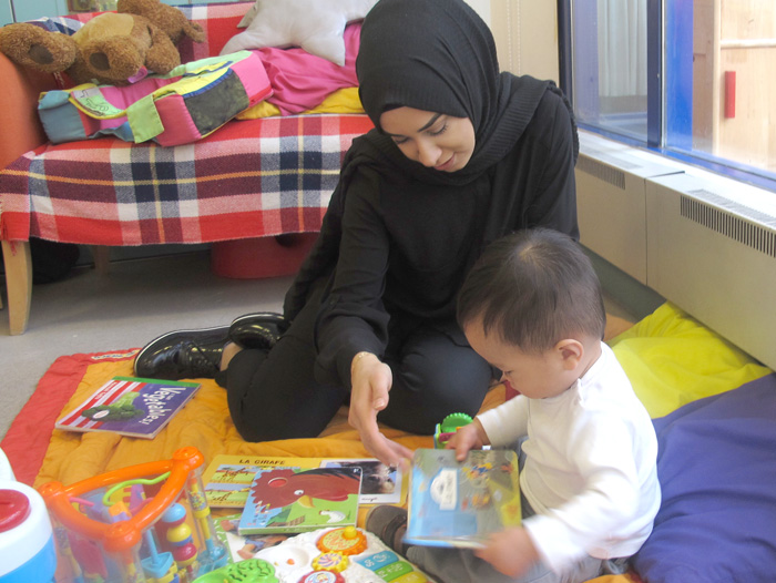 Children's Centre Volunteer playing with toddler