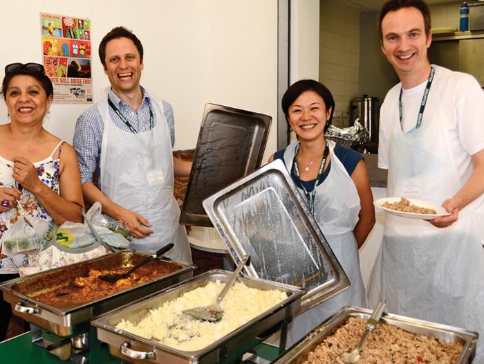 Four cooks volunteering in Masbro Centre kitchen