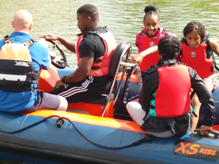 Masbro Youth Centre members in boat on river